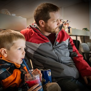 A father and son watch a Battalion game together