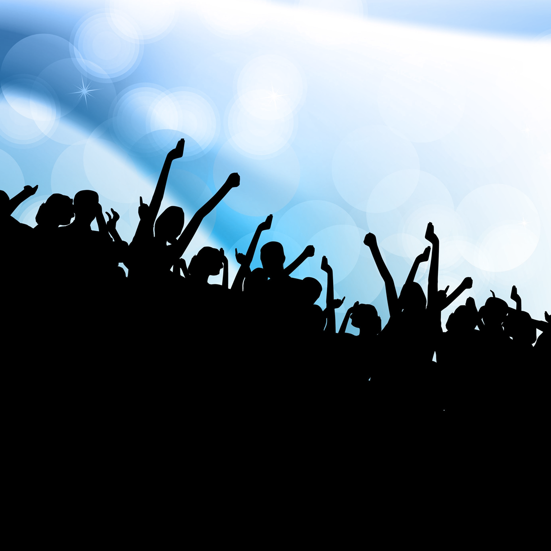 Silhouette of a crowd cheering at a concert