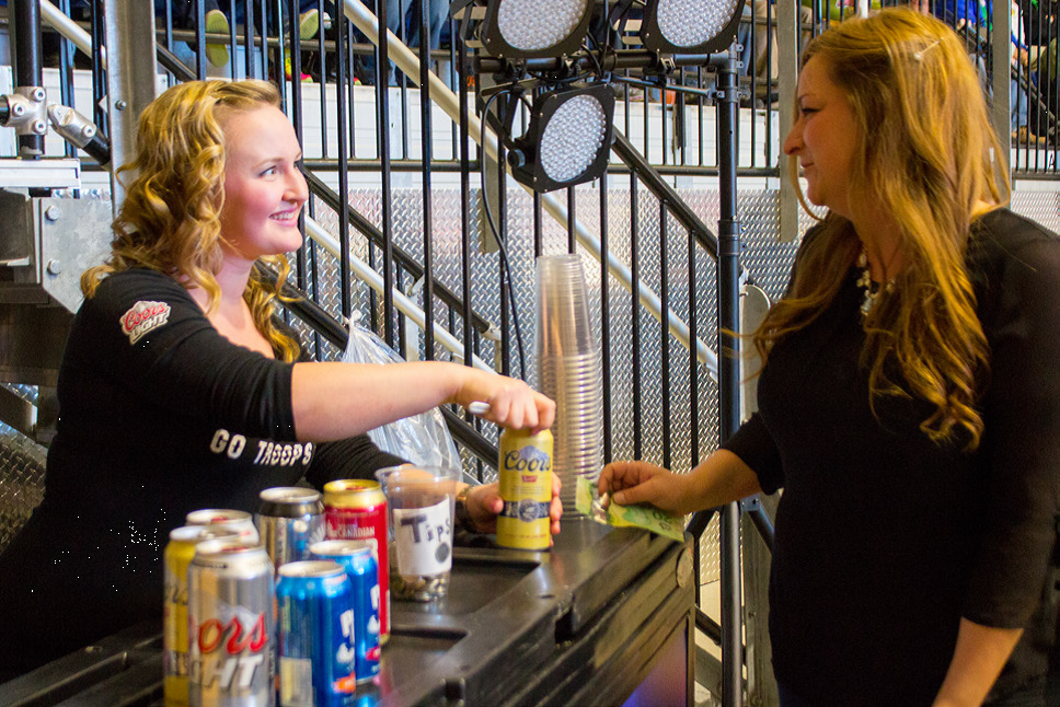 Patron purchasing a beverage at one of the portable bar locations